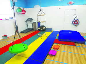 Trained physical therapists work with children at More Than A Gym.