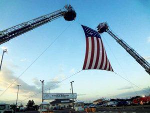 A flag flies over the proceedings. (Photos by Chris Boyle)