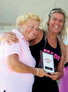 Women's Athena Masters champion Bernadette Winnubst of Bayville is congratulated by Nassau County  Legislator Rose Walker.