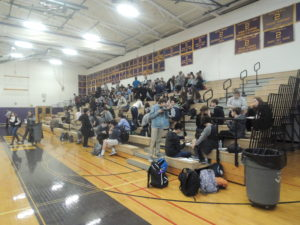 Students chowing down on the gym bleachers during the luncheon mixer portion of Career Day.