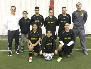 The soccer team at Mill Neck Manor School for the Deaf competed in the Oct. 21-22 ESDAA Tournament in Rochester. In the front: Keren Guerra, Noel Rodriguez and Kevin Canales. In back: Coach Larry Manning, Nataly Osorio, Julio Reyes, Bianca Llorens, Jose Yanes and Coach Tony Albicocco.